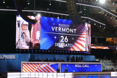 Dottie announces Vermont's votes with Aster over her shoulder