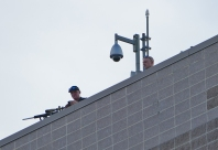 Snipers observing the protest from the rooftop.